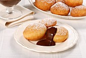 Bomboloni (Italian doughnuts) with chocolate sauce