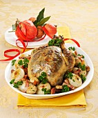 Capon with potatoes, onions and bacon for Christmas
