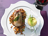 Braised quail on a bed of lentils with apple and leek