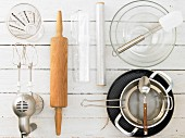 Kitchen utensils for making a raspberry cream cake with a biscuit base