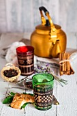Arabic Nana mint tea in a teapot and glasses with biscuits