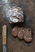 Wholemeal bread dusted with flour, sliced