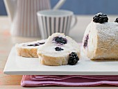A blackberry sponge roll filled with yoghurt and buttermilk cream