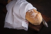 A baguette wrapped in a vintage tea towel
