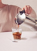 Espresso being poured over coffee ice cream
