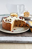 Carrot cake with dried cranberries, a piece cut