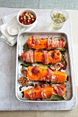 Roasted squash wedges with bacon, garlic and bay leaves