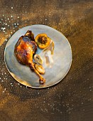 Goose leg with baked apple and chestnuts