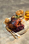 Roast duck with red cabbage and macadamia nut dumplings