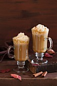 Pumpkin latte with whipped cream and maple syrup