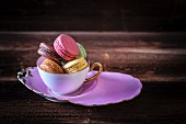 Colourful macarons in a cup