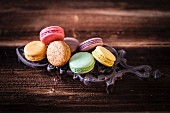 Colourful macarons arranged on a cast iron trivet
