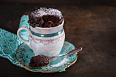 Small chocolate mug cake in a vintage cup