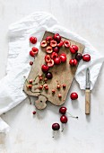 Sour cherries on a chopping board