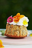A lemon and poppy seed mini cake with edible flowers