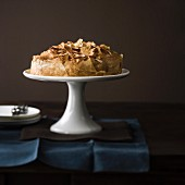 Flaky pastry cake on a cake stand