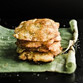 Tostones (fried plantains) on a banana leaf (Latin America)