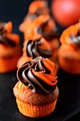 Orange muffins with a chocolate and orange frosting