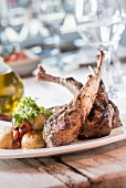 Australian wood-grilled lamb chops with lemon roasted potatoes