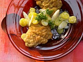 Monkfish schnitzel with asparagus and potato salad