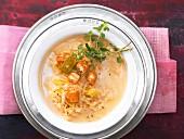 Sauerkraut soup with orange zest and croutons