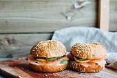 Sesame seed buns with smoked salmon, lemon and avocado