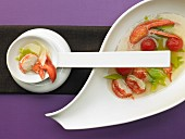 Clear lobster soup with leek and tomatoes