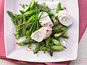 Turkey roulade on an asparagus salad with wasabi and pink pepper