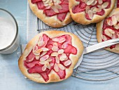 Sweet rhubarb pastry with almond leaves and vanilla yoghurt