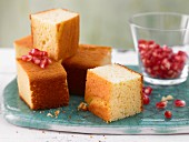 Lime cake cubes with yogurt and pomegranate seeds