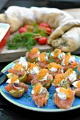 Salted salmon on potato with sour cream and roe