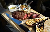 Grilled lamb fillet with rosemary butter, baked potato and aubergine