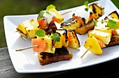 Grilled fruit skewers on toast