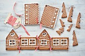 An unfinished gingerbread house and its remaining parts