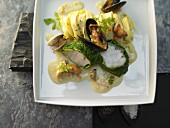 Monkfish with savoy cabbage, mussels and saffron noodles