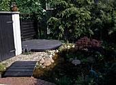 GARTENANSICHT mit Holzterrasse