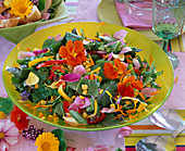 Edible flowers, salad with Tropaeolum (nasturtium)