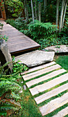 VIEW Along Front WOODEN PATH with LAWN, ROCKS, DECKING AND ASPENS. Designer Bob SWAIN, Seattle, USA
