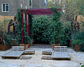 ROOF Garden: BARLEYCORN GRAVEL, BAMBOO CHAIRS, Red Pergola AND RUSTED STEEL SCULPTURE: DESIGN by ALISON WEAR ASSOCIATES