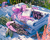 Lavandula as bottles and bouquet on blue towels