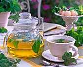 Mentha piperita (peppermint) tea in glass jug and cup