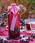 Gin with Prunus spinosa in bottle with label 'Schlehen-Gin'