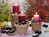 Terracotta-Töpfe als Kerzenhalter