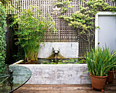 VIEW of DECKED TERRACE with RAISED Pool AND TRELLIS Designer: Christian WRIGHT, San FRANCISCO