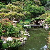 A STONE BRIDGE AND STREAM IN THE JAPANESE Garden at THE Huntington BOTANICAL GARDENS, LOS ANGELES, CALIFORNIA.