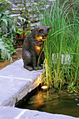 Cat SCULPTURE by DAVID ANNAND On A RAISED Pool with LIGHTING IN MR MCGREGOR'S Garden