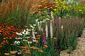 PRAIRIE PLANTING at Lady Farm: LIATRIS Spicata 'Alba', HELENIUM 'MOERHEIM BEAUTY', Echinacea PURPUREA 'White SWAN' AND CALAMAGROSTIS X ACUTIFLORA 'Karl FOERSTER