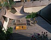 ROOF Garden: TIMBER DECKING, AWNING, DECKCHAIRS, SLATTED TRELLIS, KAUNA RUSH MATTRESS, Water RILL, STEEL Container with GLOBE ARTICHOKES: DESIGNERS PAUL THOMPSON / TREVYN MCDOWELL