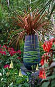 COLOURED CONCRETE Pot PLANTED with PHORMIUM: Designer: CAROLE VINCENT