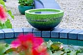 Green CONCRETE Container On Blue CONCRETE BRICKS: Designer: CAROLE VINCENT